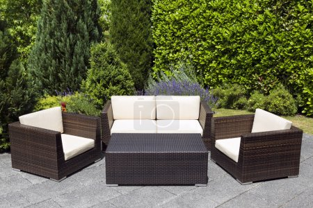 Outdoor garden furniture group in green garden