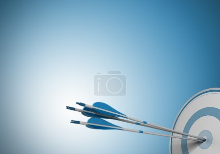 Photo for Three arrows hitting the center of a target. Image over a blue background with free space for text - Royalty Free Image