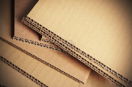 Photo for Corrugated cardboard sheets view of the side, free space on the top - Royalty Free Image