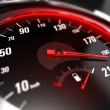 Close up of a car speedometer with the needle poin...