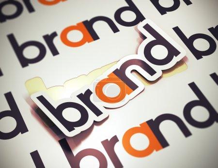 Photo pour Autocollant avec la marque de mot sur un fond beige. concept de la marque. l'image est un 3d rendu avec blur effet - image libre de droit
