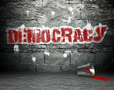 Graffiti wall with democracy, street background