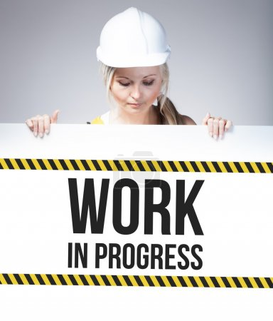 Work in progress sign on information poster, worker woman