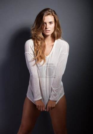 Photo for Hot woman in pajamas covering her panties - Royalty Free Image