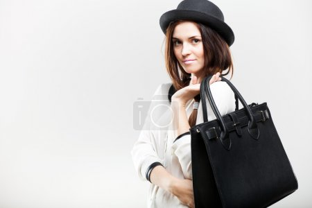 Portrait of stylish young woman with leather bag