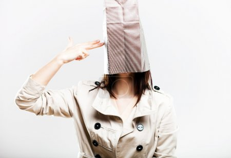 Photo for Consumerism concept, fashionable woman with shopping bag on head - Royalty Free Image