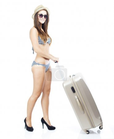 Tourist woman in bikini with suitcase isolated