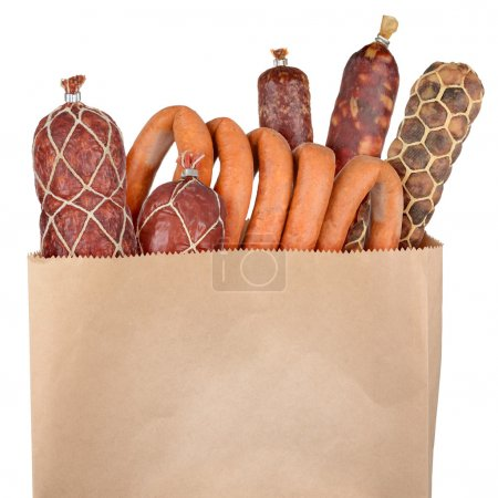 Bag of groceries isolated on white background...