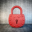 Red lock isolated on a concrete background...
