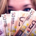 Woman with Euros in Hands. 50 Euros Bills. Horizon...