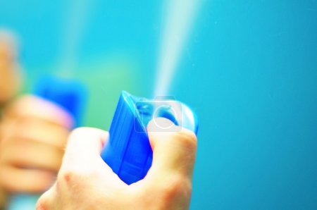 Air Freshener in Spray. Refreshing Air In Front of Bathroom Mirror.