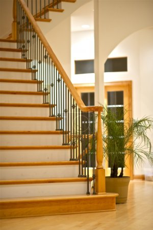 Photo for Hardwood Stairs and Large Living Room - Luxury Home Interior - Royalty Free Image