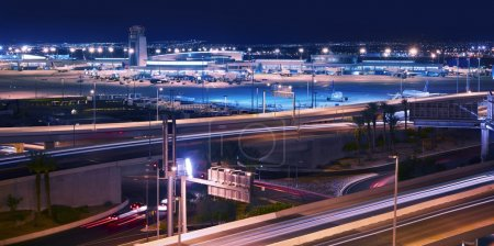 Photo for Vegas Transportation System - Las Vegas Airport and Highways System at Night. Transportation Photography Collection. Las Vegas, Nevada, U.S.A. - Royalty Free Image