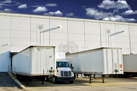 Photo for Warehouse Loading Docks - Business District. Semi Trucks and Trailers Loading. Shipping and Logistics Photography Collection. - Royalty Free Image