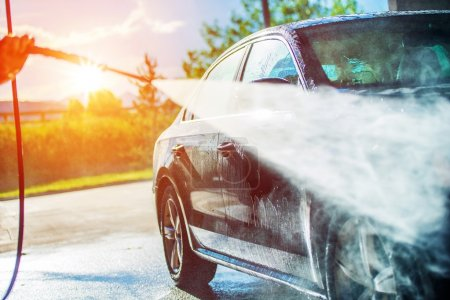 Photo for Summer Car Washing. Cleaning Car Using High Pressure Water. - Royalty Free Image