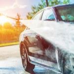 Summer Car Washing. Cleaning Car Using High Pressu...
