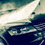 Car Wash Closeup. Washing Modern Car by High Press...