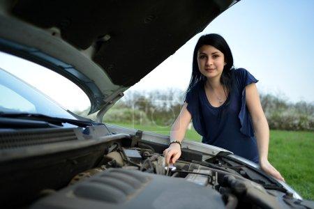 Beautiful woman sad with broken car