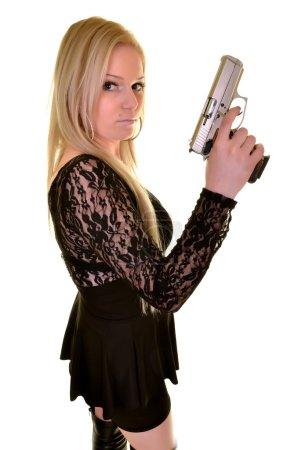 Beautiful young woman with gun