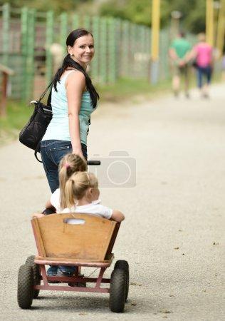 Little girls in a cart