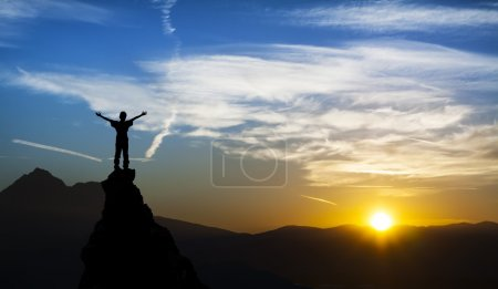 Photo for Man on the top of a rock meeting sun - Royalty Free Image