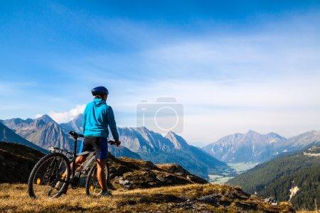 Photo for Mountain biking - woman on bike, Dolomites, Italy - Royalty Free Image