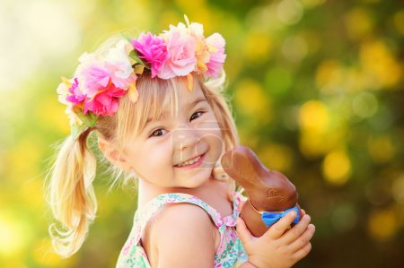 Photo for Cute easter girl with chocolate bunny outdoor - Royalty Free Image