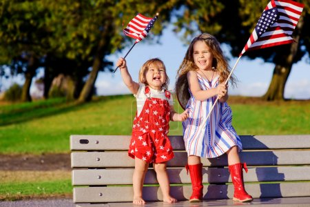 Little girls waving American flag