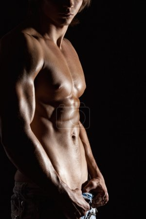 Photo for Closeup of strong athletic man on studio background, closeup - Royalty Free Image