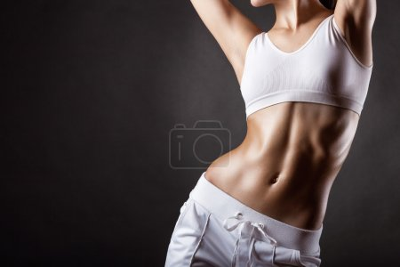 Photo for Closeup of body of young athletic woman, studio shot sporty lady in sportswear - Royalty Free Image