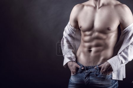Photo for Healthy young muscular man on a gray background - Royalty Free Image