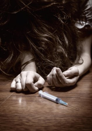 Young woman with drug