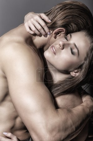 Photo for Young beautiful loving couple embracing, closeup studio portrait - Royalty Free Image