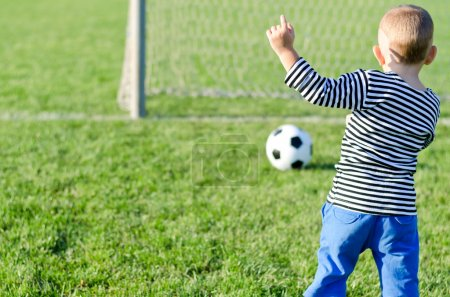 Young boy kicking a soccer ball