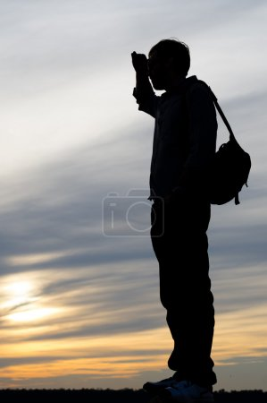 Silhouette of a man scanning the horizon