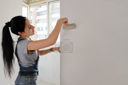 Woman painting an apartment