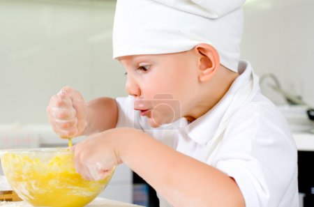 Gleeful young chef baking in the kitchen