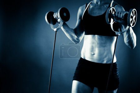 Torso of a young fit woman working out