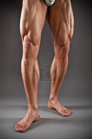 Photo for Muscular male legs in studio - Royalty Free Image