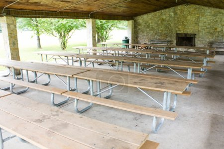 Row of picnic tables in a shelter house