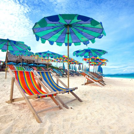 Colorful parasols on a tropical island beach.