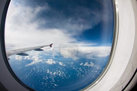 Photo for Clouds and sky as seen through window of an aircraft - Royalty Free Image