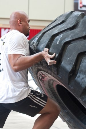 Contender for Strongman Sulaiman Ismail attempting the six times 350kg tyre flip
