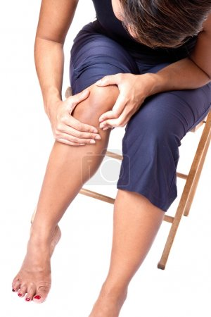 Young woman suffering from knee pain
