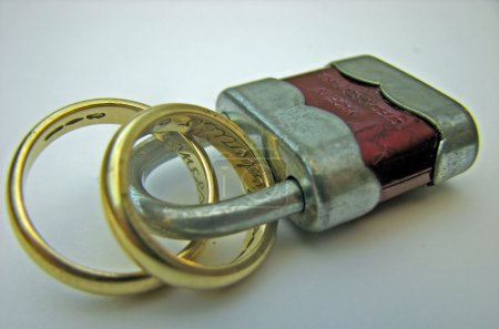 Padlock with two wedding rings linked together forever