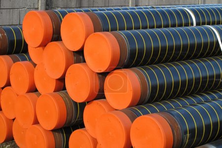 Photo for Piles of plastic pipes and conduits for transporting water and gas - Royalty Free Image