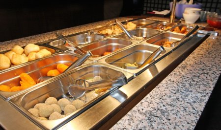 Tray filled with food inside the self service Chinese restaurant