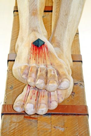 nailed and bleeding feet of Jesus in the chruch