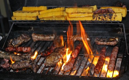 Sausage and grilled pork during a barbecue