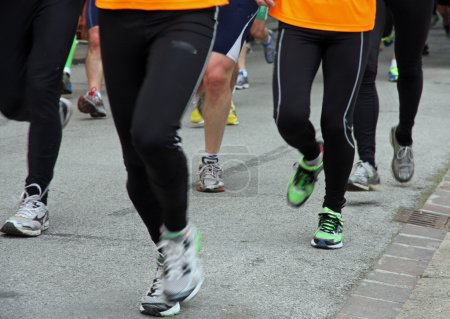 Athletes shoes runners during a race in the city